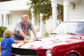 Grandfather And Grandson Cleaning  Car — Stock Photo
