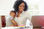 Mother With Baby Working — Stock Photo