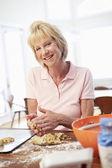 Senior Woman Baking Cookies — Stock Photo
