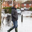 Man Walking Along Flooded Urban Street — Stock Photo #68248709