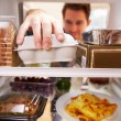 Man Looking Inside Fridge — Stock Photo #68248741