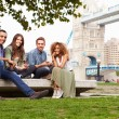 Friends Relaxing By Tower Bridge — Stock Photo #68248747