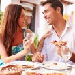 Young Couple Eating Meal — Stock Photo #68249077