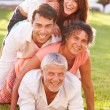 Multi Generation Family  On Grass Together — Stock Photo #68249403