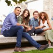 Friends Relaxing By Tower Bridge — Stock Photo #68249511