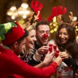 Group Of Friends Enjoying Christmas Drinks — Stok fotoğraf #68249919