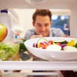Man Looking Inside Fridge — Stock Photo #68249929