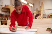 Apprentice Working With Plans — Stock Photo