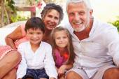 Grandparents With Grandchildren In Garden — Stock Photo