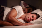 Man Lying Awake In Bed — Stock Photo