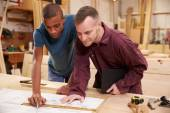Carpenter With Apprentice  In Workshop — Stock Photo