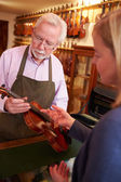 Customer Leaving Violin For Repair — Stock Photo