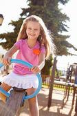 Girl Having Fun On Seesaw — Stock Photo