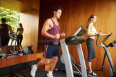 Couple Exercising In Home Gym — Stock Photo
