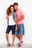 Couple Standing Against Wall — Stockfoto
