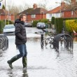 Man Walking Along Flooded Urban Street — Stock Photo #68250139