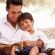 Father And Son Reading Book — Stock Photo #68250251