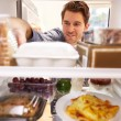 Man Looking Inside Fridge — Stock Photo #68250527