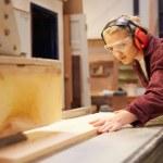 Female Apprentice Using Circular Saw — Stock Photo #68250967