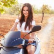 Young Woman Riding Motor Scooter — Stock Photo #68251107