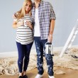 Couple Decorating Nursery For Baby — Stock Photo #68251309