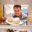 Man Looking Inside Fridge — Stock Photo #68251429