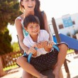 Mother And Son On Seesaw — Stock Photo #68251451