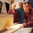 Carpenter With Apprentices Using Circular Saw — Stock Photo #68251519