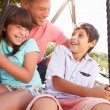 Father And Children  On Swing — Stock Photo #68251585