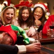 Man Passed Out On Bar During Christmas — Stock Photo #68252231