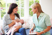 Mother and Baby With Health Visitor — Stock Photo
