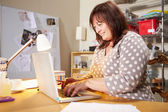 Woman Checking Orders  On Laptop — Stock Photo