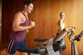 Couple Exercising In Home Gym — Foto de Stock
