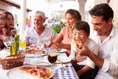 Multi Generation Family Eating Meal — Stock Photo