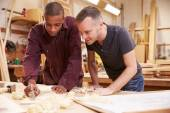Carpenter With Apprentice Planing Wood — Stock Photo