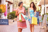 Mother With Adult Daughter with Shopping Bags — Stock Photo