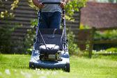 Man Working In Garden Cutting Grass — Stock Photo