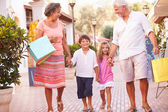 Grandparents With Grandchildren with Shopping Bags — Stock Photo