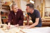 Carpenter With Female Apprentice Planing Wood — Stock Photo