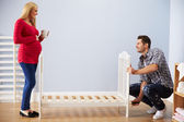 Couple Assembling Cot In Nursery — Stock Photo