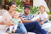 Family Sitting Outdoors In Garden — Stock Photo