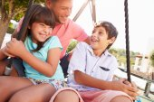 Father And Children  On Swing — Stock Photo