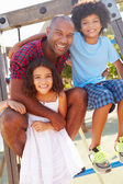Father With Children On Playground — Stock Photo