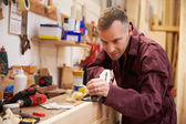 Carpenter Planing Wood — Stock Photo
