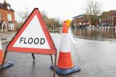 Traffic Sign On Flooded Road — Stock Photo