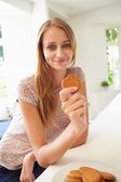 Woman Eats Ginger Biscuit — Stock Photo