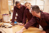 Carpenter With Apprentices Finishing Wood — Stock Photo