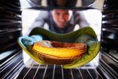 Man Putting Savoury Pie Into Oven — Stock Photo