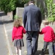Father Walking To School With Children — Stock Video #71412671