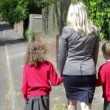 Mother Walking To School With Children — Stock Video #71413811